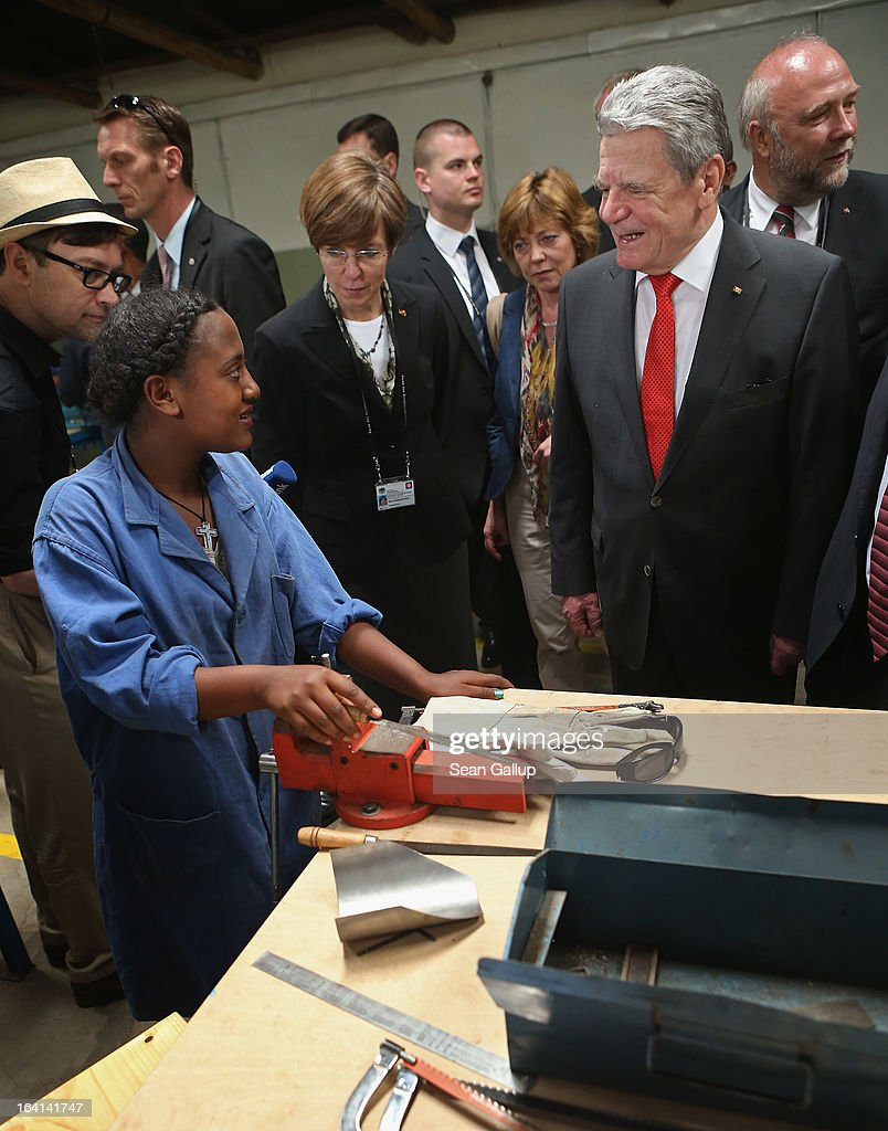 German President Joachim Gauck chats with students in the metal working class at the AA Tegbare-id Polytechnic College during a visit on March 20, 2013 in Addis Ababa, Ethiopia. The AA Tegbare-id Polytechnic College is supported by Germany's KFW Development Bank and the GEZ as well as the Italian government. President Gauck and First Lady Daniela Schadt are in Ethiopia on the last of a four-day state visit.