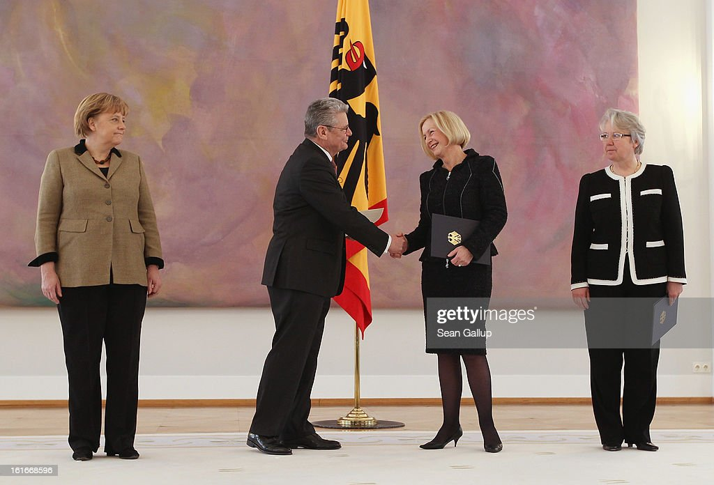 German President <a gi-track='captionPersonalityLinkClicked' href=/galleries/search?phrase=Joachim+Gauck&family=editorial&specificpeople=2077888 ng-click='$event.stopPropagation()'>Joachim Gauck</a> congratulates incoming German Education Minister <a gi-track='captionPersonalityLinkClicked' href=/galleries/search?phrase=Johanna+Wanka&family=editorial&specificpeople=5626570 ng-click='$event.stopPropagation()'>Johanna Wanka</a> after handing her her appointment papers as outgoing Education Minister <a gi-track='captionPersonalityLinkClicked' href=/galleries/search?phrase=Annette+Schavan&family=editorial&specificpeople=599358 ng-click='$event.stopPropagation()'>Annette Schavan</a> (R) and Chancellor <a gi-track='captionPersonalityLinkClicked' href=/galleries/search?phrase=Angela+Merkel&family=editorial&specificpeople=202161 ng-click='$event.stopPropagation()'>Angela Merkel</a> look on at Bellevue Palace on February 14, 2013 in Berlin, Germany. Schavan resigned recently following confirmation from the University of Dusseldorf that she had plagiarized portions of her doctoral thesis while she was a student 30 years ago.