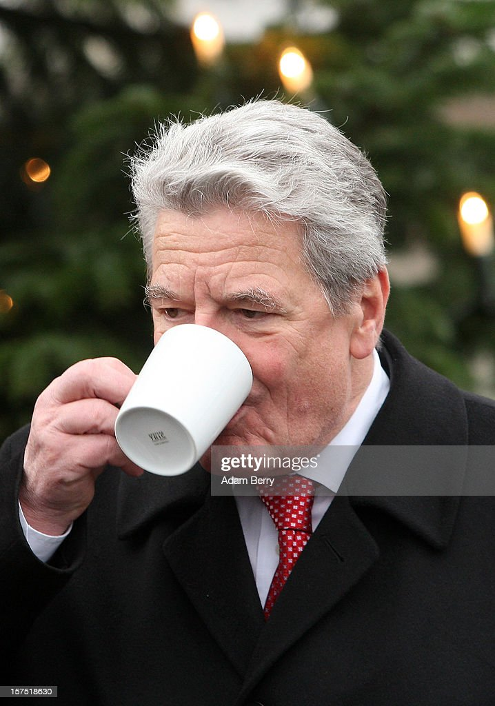 German President Joachim Gauck drinks mulled punch during the illumination ceremony for the Christmas tree at Bellevue Presidential Palace on December 4, 2012 in Berlin, Germany. The 12-meter (40-foot) tall Colorado blue spruce (Picea pungens) was planted in 1994 and is being supplied to the president for the second time by Werderaner Tannenhof Christmas tree farm in the town of Werder, just outside of the German capital.
