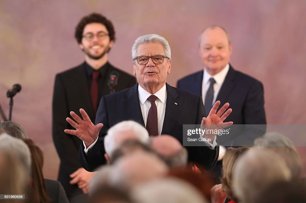 German President Joachim Gauck gestures to the audience as he stands in front of musicians after he gave a speech to mark the end of his term as president at Schloss Bellevue palace on January 18, 2017 in Berlin, Germany. Gauck, a former pastor, chose not to serve a second term. The Federal Assembly will elect his successor on February 12.