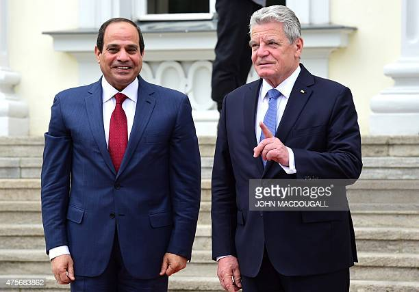 German President Joachim Gauck greets Egyptian President Abdel Fattah alSisi at his residence Schloss Bellevue castle on June 3 2015 in Berlin AFP...