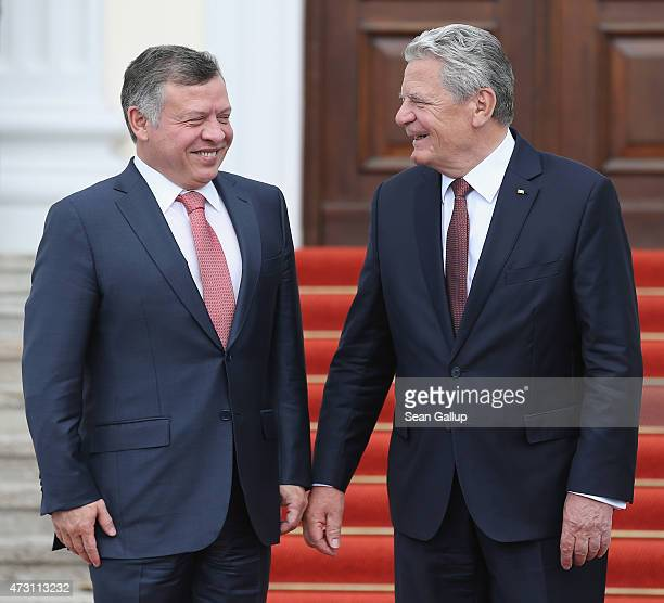 German President Joachim Gauck greets King Abdullah II of Jordan upon King Abdullah's arrival at Schloss Bellevue Palace on May 13 2015 in Berlin...