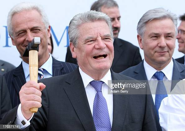 German President Joachim Gauck hammers the foundation stone at the cornerstonelaying ceremony for the Berliner Schloss city palace as German...