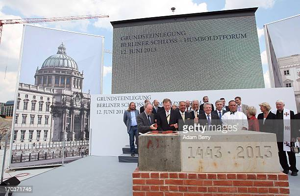German President Joachim Gauck hammers the foundation stone at the cornerstonelaying ceremony for the Berliner Schloss city palace on June 12 2013 in...