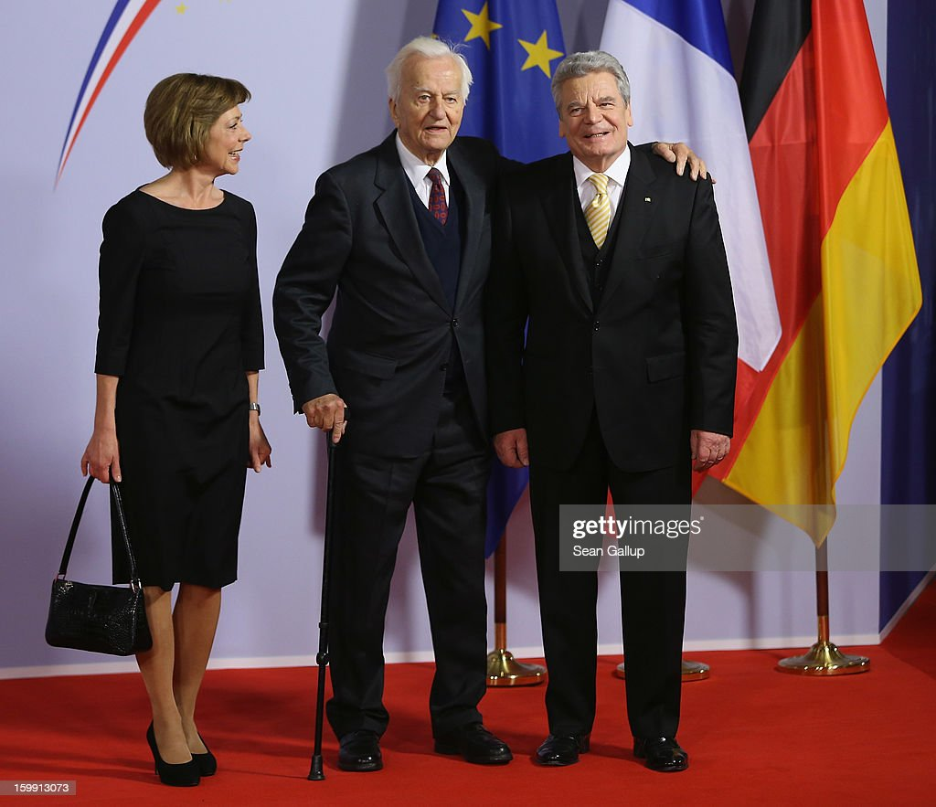 German President <a gi-track='captionPersonalityLinkClicked' href=/galleries/search?phrase=Joachim+Gauck&family=editorial&specificpeople=2077888 ng-click='$event.stopPropagation()'>Joachim Gauck</a> (R), his partner <a gi-track='captionPersonalityLinkClicked' href=/galleries/search?phrase=Daniela+Schadt&family=editorial&specificpeople=7055235 ng-click='$event.stopPropagation()'>Daniela Schadt</a> and former German President Richard von Weizsaecker attend a concert at the Berlin Philharmonic during the 50th anniversary celebration of the Elysee Treaty on January 22, 2013 in Berlin, Germany. The treaty, concluded in 1963 by Charles de Gaulle and Konrad Adenauer in the Elysee Palace in Paris, set a new tone of reconciliation between France and Germany, and called for consultations between the two countries to come to a common stance on policies affecting the most important partners in Europe as well as the rest of the region. Since its establishment, the document for improved bilateral relations has been seen by many as the driving force behind European integration.