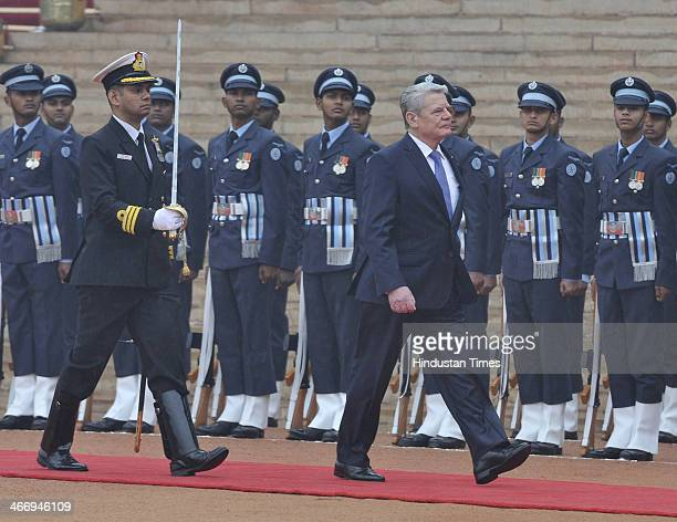 German President Joachim Gauck inspects a guard of honour during his ceremonial reception at the forecourt of India's Rashtrapati Bhavan presidential...