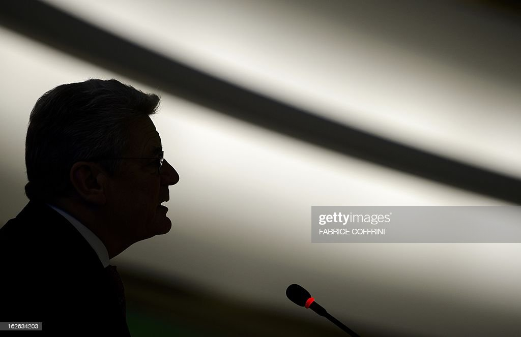 German President Joachim Gauck is seen in silhouette as he addresses the assembly on the opening day of the 22nd session of the United Nations Human Rights Council on February 25, 2013 in Geneva. The Council kicks off with widespread abuses in North Korea and Mali the top items on the agenda, along with the crisis in Syria.