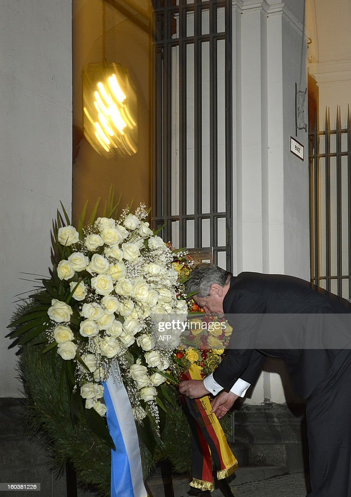 German President Joachim Gauck lays a wreath to commemorate the anti-Fascist's siblings Hans and Sophie Scholl at the university in Munich, southern Germany, on January 30, 2013. Hans and his sister Sophie were members of the student group 'Weisse Rose' (White Rose), that acted in the non- violent resistance during the Nazi regime. On February 22, 1943 they were sentenced to death and executed by guillotine.