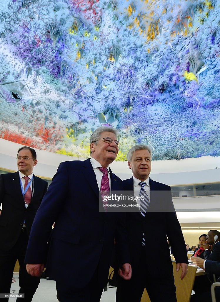 German President Joachim Gauck (C) leaves beneath a ceiling painted by Spanish artist Miquel Barcelo after addressing the opening day of the 22nd session of the United Nations Human Rights Council on February 25, 2013 in Geneva. The Council kicks off with widespread abuses in North Korea and Mali the top items on the agenda, along with the crisis in Syria. AFP PHOTO / FABRICE COFFRINI