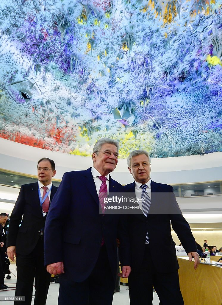 German President Joachim Gauck (C) leaves beneath a ceiling painted by Spanish artist Miquel Barcelo after addressing the opening day of the 22nd session of the United Nations Human Rights Council on February 25, 2013 in Geneva. The Council kicks off with widespread abuses in North Korea and Mali the top items on the agenda, along with the crisis in Syria.
