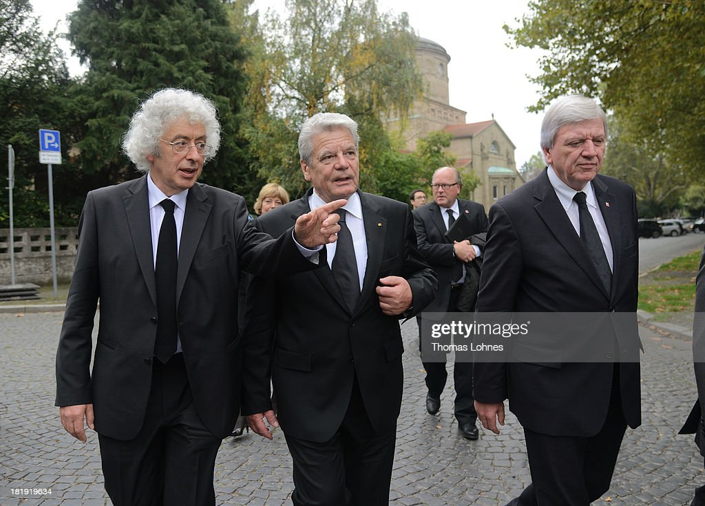 German President <a gi-track='captionPersonalityLinkClicked' href=/galleries/search?phrase=Joachim+Gauck&family=editorial&specificpeople=2077888 ng-click='$event.stopPropagation()'>Joachim Gauck</a> (C), Marcel Reich-Ranicki's son Andrew Ranicki (L) and the prime minister of Hesse, <a gi-track='captionPersonalityLinkClicked' href=/galleries/search?phrase=Volker+Bouffier&family=editorial&specificpeople=2371294 ng-click='$event.stopPropagation()'>Volker Bouffier</a>, walk after the funeral service for the literary critic Marcel Reich-Ranicki (1920 - 2013) on September 26, 2013 in Frankfurt am Main, Germany.
