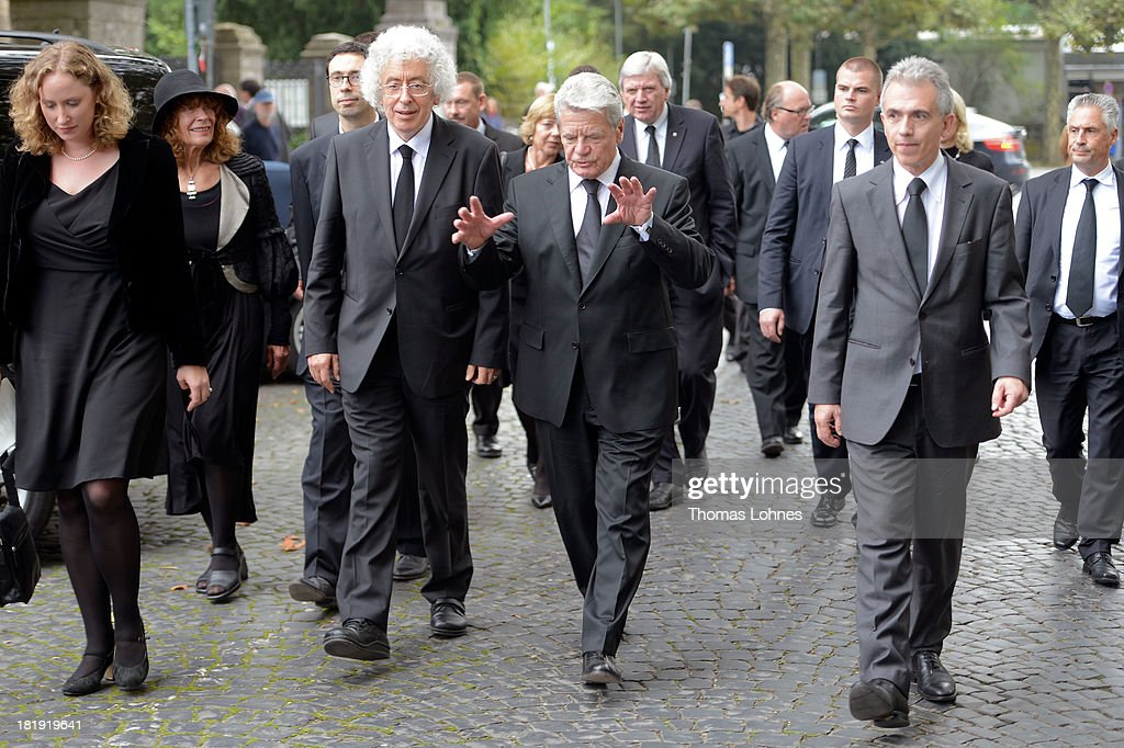German President <a gi-track='captionPersonalityLinkClicked' href=/galleries/search?phrase=Joachim+Gauck&family=editorial&specificpeople=2077888 ng-click='$event.stopPropagation()'>Joachim Gauck</a> (C), Marcel Reich-Ranicki's son Andrew Ranicki (3rd L) and the major of Frankfurt Peter Feldmann (2nd R) after the funeral service for the literary critic Marcel Reich-Ranicki (1920 - 2013) on September 26, 2013 in Frankfurt am Main, Germany.