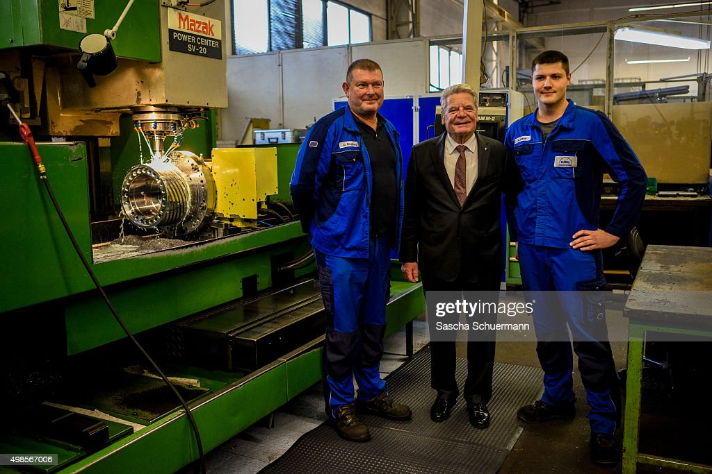 German President Joachim Gauck meets trainees at a job training facility at W. Eubel GmbH machine manufacturer on November 24, 2015 in Cologne, Germany. German industry has complained in recent years of being unable to fill tens of thousands of trainee positions and some see the influx of nearly a million migrants this year as a possible opportunity to narrow the gap.
