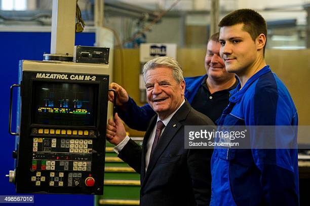 German President Joachim Gauck meets trainees at a job training facility at W Eubel GmbH machine manufacturer on November 24 2015 in Cologne Germany...