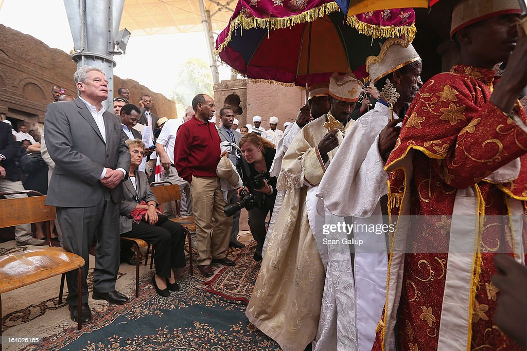 German President Joachim Gauck observes Ethiopian Orthodox clergy perform a ritual celebrating the Virgin Mary outside St. Mary's Church on March 19, 2013 in Lalibela, Ethiopia. Lalibela is among Ethiopia's holiest of cities and is distinguished by its 11 churches hewn into solid rock that date back to the 12th century. President Gauck and First Lady Daniela Schadt are on the third of a four-day state visit to Ethiopia.