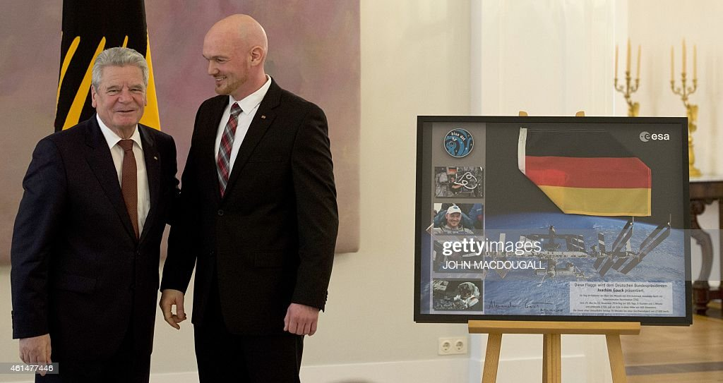 German President <a gi-track='captionPersonalityLinkClicked' href=/galleries/search?phrase=Joachim+Gauck&family=editorial&specificpeople=2077888 ng-click='$event.stopPropagation()'>Joachim Gauck</a> (L) poses with German astronaut <a gi-track='captionPersonalityLinkClicked' href=/galleries/search?phrase=Alexander+Gerst&family=editorial&specificpeople=5862799 ng-click='$event.stopPropagation()'>Alexander Gerst</a> after giving him the Officer's Cross of the Order of Merit of the Federal Republic of Germany during a ceremony at the presidential palace January 13, 2015. Gerst, a European Space Agency astronaut and geophysicist, was part of the International Space Station ( ISS ) crew from May to November 2014.
