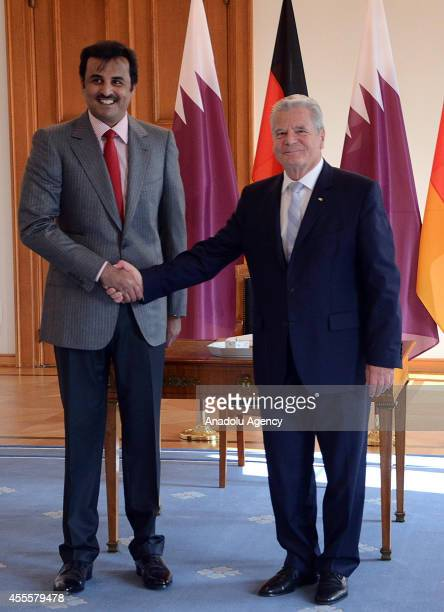 German President Joachim Gauck shake hands with Qatar's emir Sheikh Tamim bin Hamad Al Thani at Bellevue Palace in Berlin Germany on September 17 2014