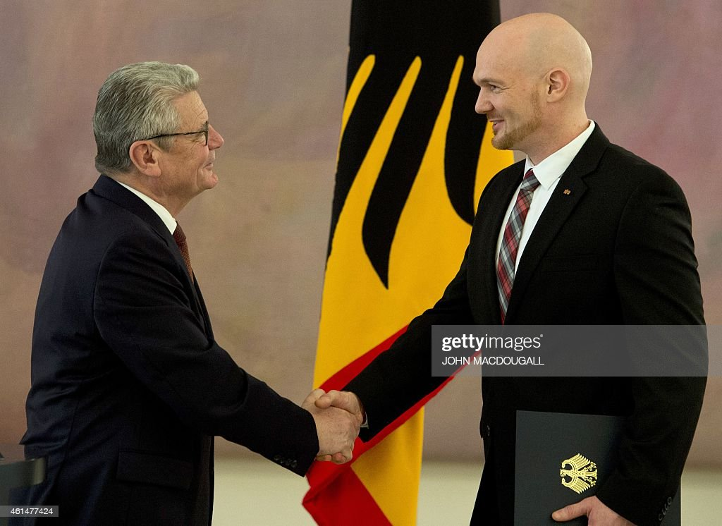 German President <a gi-track='captionPersonalityLinkClicked' href=/galleries/search?phrase=Joachim+Gauck&family=editorial&specificpeople=2077888 ng-click='$event.stopPropagation()'>Joachim Gauck</a> (L) shakes hands with German astronaut <a gi-track='captionPersonalityLinkClicked' href=/galleries/search?phrase=Alexander+Gerst&family=editorial&specificpeople=5862799 ng-click='$event.stopPropagation()'>Alexander Gerst</a> after giving him the Officer's Cross of the Order of Merit of the Federal Republic of Germany during a ceremony at the presidential palace January 13, 2015. Gerst, a European Space Agency astronaut and geophysicist, was part of the International Space Station ( ISS ) crew from May to November 2014.
