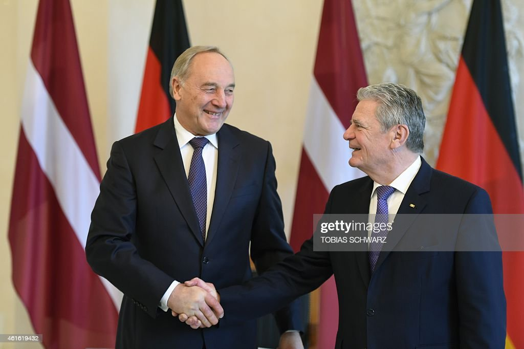 German President <a gi-track='captionPersonalityLinkClicked' href=/galleries/search?phrase=Joachim+Gauck&family=editorial&specificpeople=2077888 ng-click='$event.stopPropagation()'>Joachim Gauck</a> (R) shakes hands with his Latvian counterpart Andris Berzins on January 16, 2015 at Bellevue Palace in Berlin.