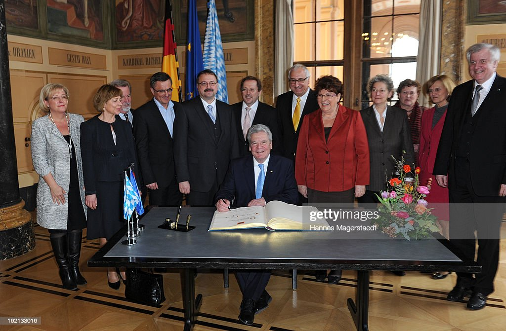 German President <a gi-track='captionPersonalityLinkClicked' href=/galleries/search?phrase=Joachim+Gauck&family=editorial&specificpeople=2077888 ng-click='$event.stopPropagation()'>Joachim Gauck</a> signs the golden book during his inaugural official visit to Bavaria at the Bavarian state parliament on February 19, 2013 in Munich, Germany. Following his visit to the Bavarian State Chancellery President Gauck's schedule includes visits to the German Aerospace Center in Oberpfaffenhofen and a panel discussion with students at the university of Regensburg.