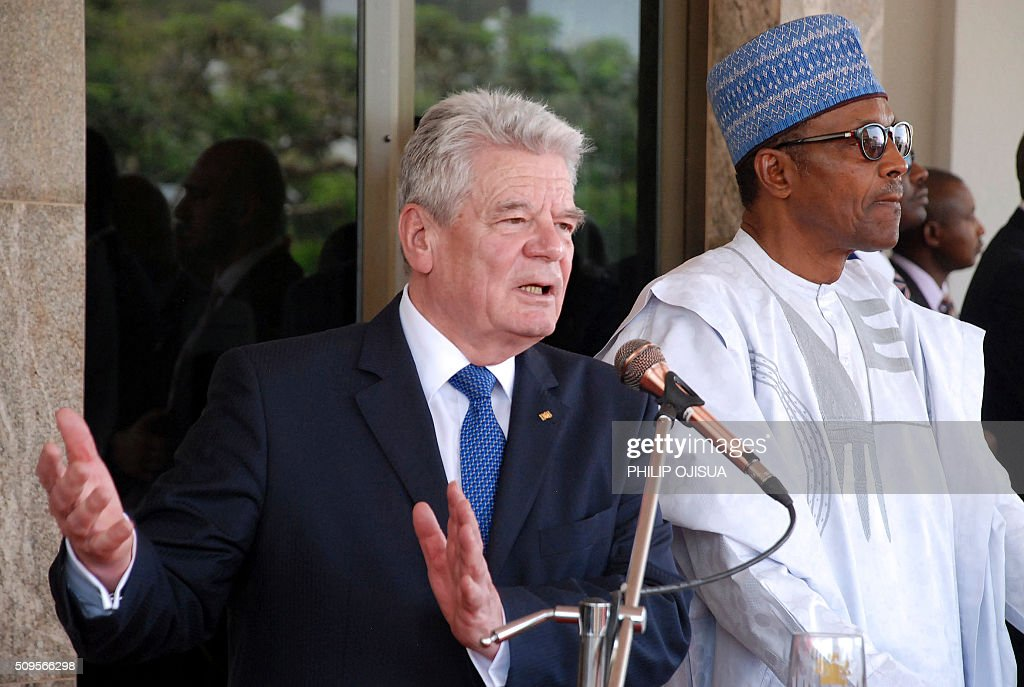 German President Joachim Gauck (R) speaks beside Nigeria's President Muhammadu Buhari (L) during a joint press briefing at the presidency in Abuja, on February 11, 2016. Gauck, accompanied by his partner and top government functionaries as well as strong delegation from the business community, is in Nigeria to strengthen cooperation between the two countries. / AFP / PHILIP OJISUA