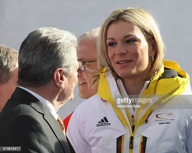 German president Joachim Gauck speaks to German skier Maria HoeflRiesch during a welcome reception for the German Olympic team at Airport Munich on...