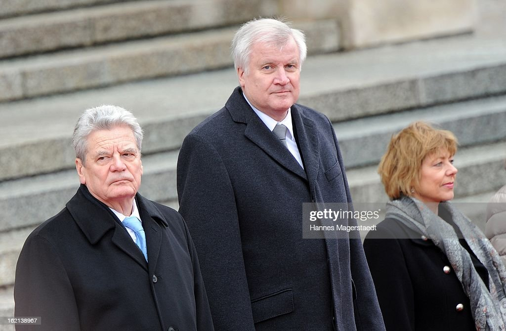 German President Joachim Gauck stands with Bavarian state governor Horst Seehofer and partner Daniela Schadt stand in front of a guard of honour outside the Bavarian State chancellery, during his inaugural official visit to Bavaria on February 19, 2013 in Munich, Germany. Following his visit to the Bavarian State Chancellery President Gauck's schedule includes visits to the German Aerospace Center in Oberpfaffenhofen and a panel discussion with students at the university of Regensburg.