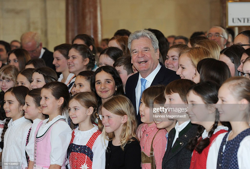 German President <a gi-track='captionPersonalityLinkClicked' href=/galleries/search?phrase=Joachim+Gauck&family=editorial&specificpeople=2077888 ng-click='$event.stopPropagation()'>Joachim Gauck</a> stands with children during his inaugural official visit to Bavaria and the Bavarian state parliament on February 19, 2013 in Munich, Germany. Following his visit to the Bavarian State Chancellery President Gauck's schedule includes visits to the German Aerospace Center in Oberpfaffenhofen and a panel discussion with students at the university of Regensburg. on February 19, 2013 in Munich, Germany.