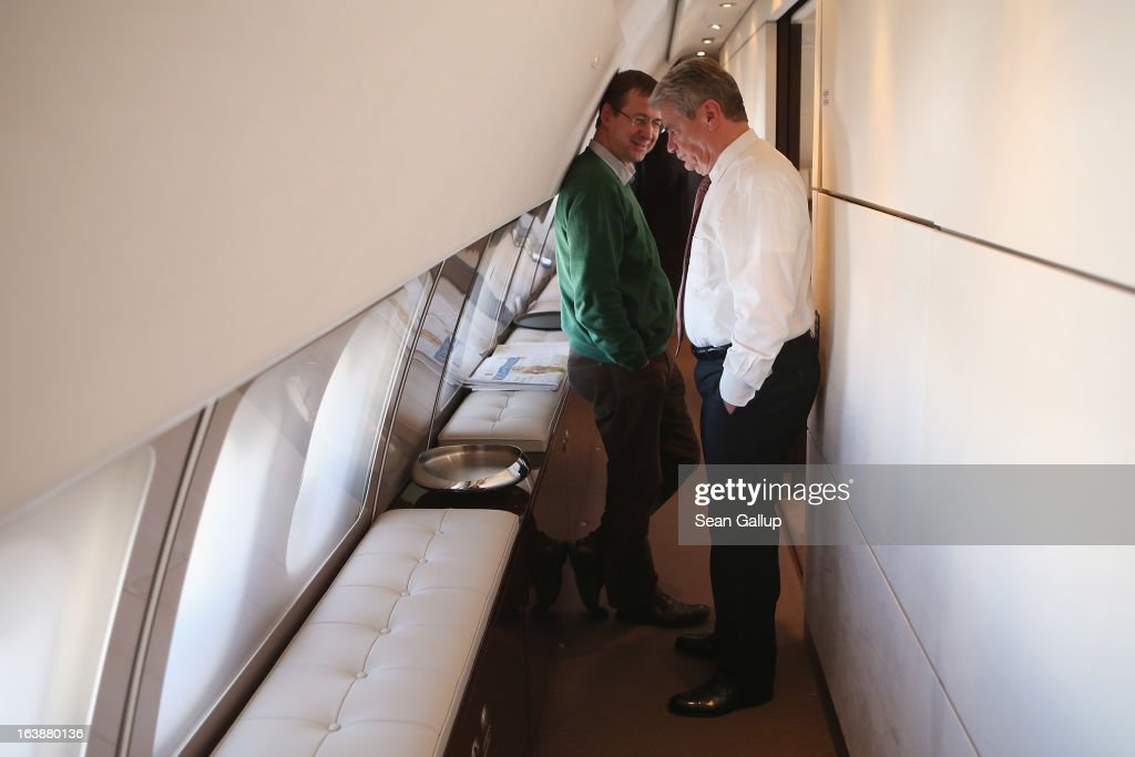 German President <a gi-track='captionPersonalityLinkClicked' href=/galleries/search?phrase=Joachim+Gauck&family=editorial&specificpeople=2077888 ng-click='$event.stopPropagation()'>Joachim Gauck</a> (R) talks with State Secretary and head of the Federal Presidential Office David Gill while in flight on their way on March 17, 2013 to Addis Ababa, Ethiopia. President Gauck and his partner Daniela Schadt will travel to Ethiopia for a four-day state visit.