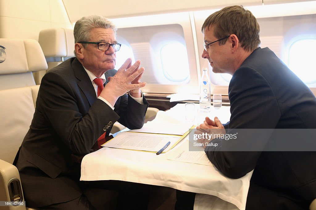 German President Joachim Gauck (L) talks with State Secretary and head of the Federal Presidential Office David Gill on their return from a state visit to Ethiopia on March 20, 2013 on board the presidential plane over eastern Germany. President Gauck and First Lady Dabniela Schadt spent four days in Ethiopia.