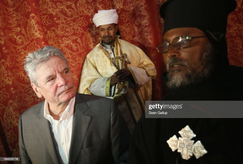 German President Joachim Gauck walks with Ethiopian Orthodox clergy while visiting St. George's Church on March 19, 2013 in Lalibela, Ethiopia. Lalibela is among Ethiopia's holiest of cities and is distinguished by its 11 churches hewn into solid rock that date back to the 12th century. President Gauck and First Lady Daniela Schadt are on the third of a four-day state visit to Ethiopia.