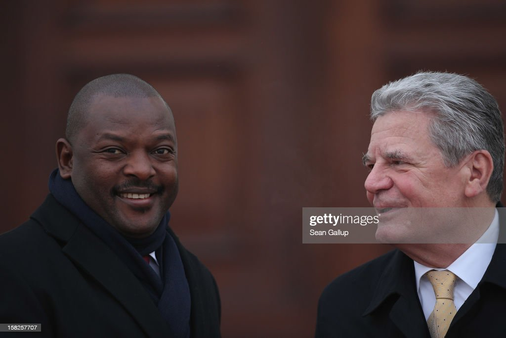 German President <a gi-track='captionPersonalityLinkClicked' href=/galleries/search?phrase=Joachim+Gauck&family=editorial&specificpeople=2077888 ng-click='$event.stopPropagation()'>Joachim Gauck</a> (R) welcomes Burundi President <a gi-track='captionPersonalityLinkClicked' href=/galleries/search?phrase=Pierre+Nkurunziza&family=editorial&specificpeople=563215 ng-click='$event.stopPropagation()'>Pierre Nkurunziza</a> at Schloss Bellevue presidential palace on December 12, 2012 in Berlin, Germany. Nkurunziza is in Berlin to promote ties between Germany and Burundi.