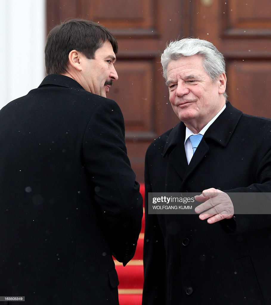 German President Joachim Gauck (R) welcomes Hungarian President Janos Ader (L) at the presidential Bellevue Palace in Berlin, Germany, on March 11, 2013. President Ader arrived for an official state visit of several days.
