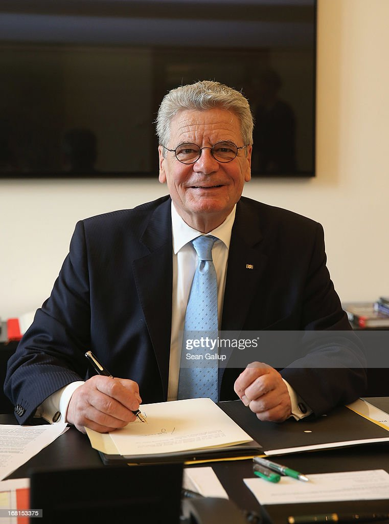 German President <a gi-track='captionPersonalityLinkClicked' href=/galleries/search?phrase=Joachim+Gauck&family=editorial&specificpeople=2077888 ng-click='$event.stopPropagation()'>Joachim Gauck</a> works at his desk at Schloss Bellevue presidential palace on May 6, 2013 in Berlin, Germany. Gauck, a former Protestant pastor, succeeded Christian Wulff, who resigned last year following allegations of receiving improper benefits while he was governor of Lower Saxony.