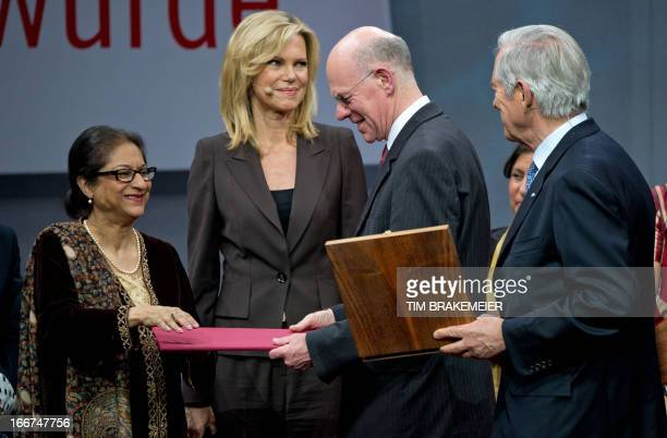 German President of the lower house of parliament Norbert Lammert awards Pakistani women rights activist Asma Jahangir with the Roland Berger Prize...