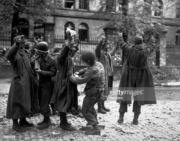 German prisoners captured in the streets of the German town of Aachen
