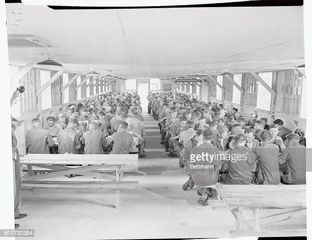 German prisoners of war are shown in the mess hall in the internment area at Camp Breckinbridge Ky one of the country's many prison camps now being...
