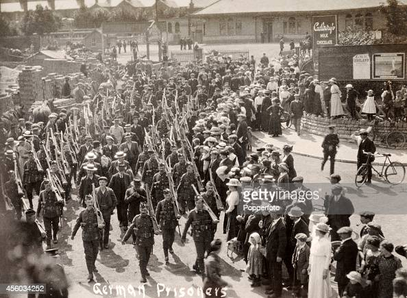 German prisoners of war marching amidst a crowd of onlookers in England circa 1918