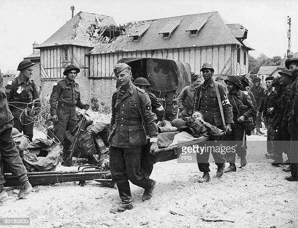 German prisoners of war working as stretcherbearers for Canadian forces taking part in the Normandy landings June 1944