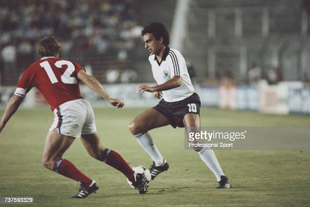 German professional footballer and midfielder with the West Germany national football team Hansi Muller pictured in action with the ball as England...