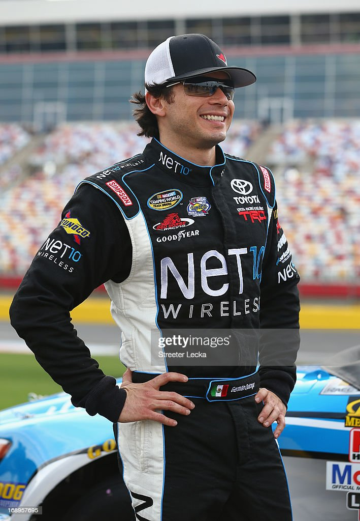 German Quiroga, driver of the #77 Net 10 Toyota, stands on pit road during qualifying for the NASCAR Camping World Truck Series North Carolina Education Lottery 200 at Charlotte Motor Speedway on May 17, 2013 in Concord, North Carolina.