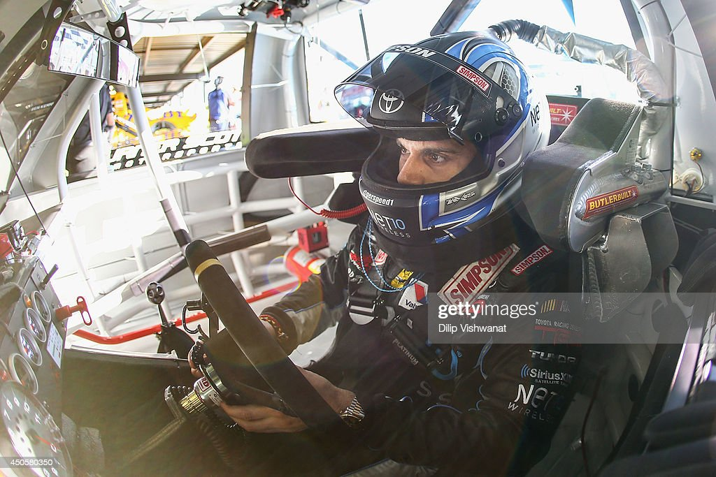 German Quiroga, driver of the #77 Net 10 Wireless Toyota waits in his truck prior to practice for the NASCAR Camping World Truck Series Drivin' for Linemen 200 at Gateway Motorsports Park on June 13, 2014 in Madison, Illinois.