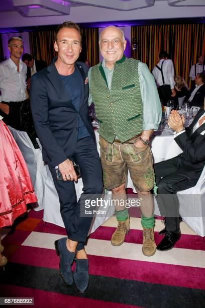 German radio presenter Jochen Bendel and Axel Munz CEO Angermaier Trachten during the Kempinski Fashion Dinner on May 23 2017 in Munich Germany