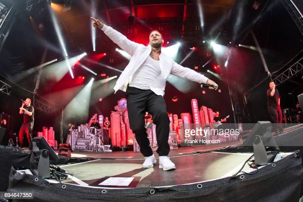 German rapper Maximilian Diehn aka Kontra K performs live on stage during a concert at the Zitadelle Spandau on June 10 2017 in Berlin Germany