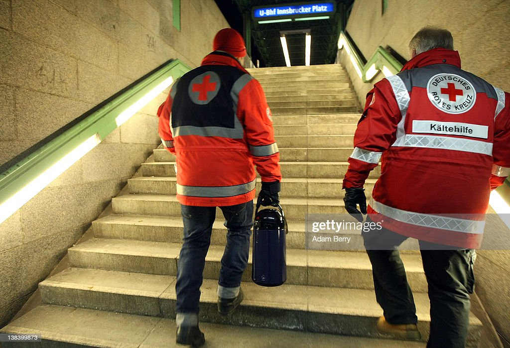 German Red Cross volunteer Adel Far (L) carries a large thermos of tea for the homeless with Carlo Trobisch as they exit the Innsbrucker Platz subway station whle making the rounds in the Waermebus, or Warmth Van, on February 6, 2012 in Berlin, Germany. The Waermebus, a program ran by the German Red Cross, assists the homeless in times of extremely low temperatures with blankets, food, clothing and finding lodging. Nearly 300 people across Europe have died during the current cold wave, a majority of whom were without shelter.