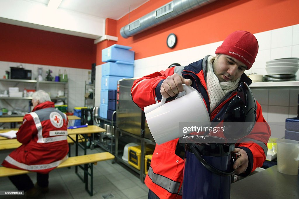 German Red Cross volunteer Adel Far (R) prepares a thermos of tea for the homeless prior to making the rounds in the Waermebus, or Warmth Van, as his colleague Carlo Trobisch writes in a log book, on February 6, 2012 in Berlin, Germany. The Waermebus, a program ran by the German Red Cross, assists the homeless in times of extremely low temperatures with blankets, food, clothing and finding lodging. Nearly 300 people across Europe have died during the current cold wave, a majority of whom were without shelter.