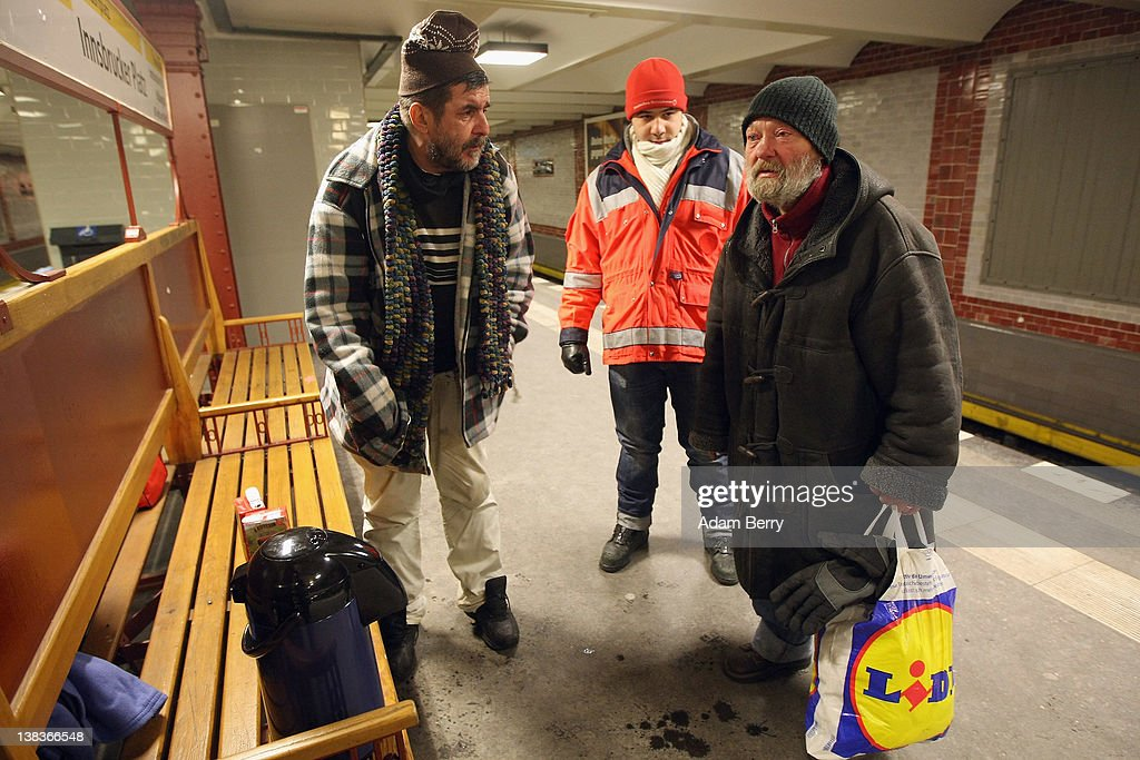 German Red Cross volunteer Adel Far (C) stands next to two homeless men in the Innsbrucker Platz subway station as Far makes the rounds in the Waermebus, or Warmth Van, on February 6, 2012 in Berlin, Germany. The Waermebus, a program ran by the German Red Cross, assists the homeless in times of extremely low temperatures with blankets, food, clothing and finding lodging. Nearly 300 people across Europe have died during the current cold wave, a majority of whom were without shelter.