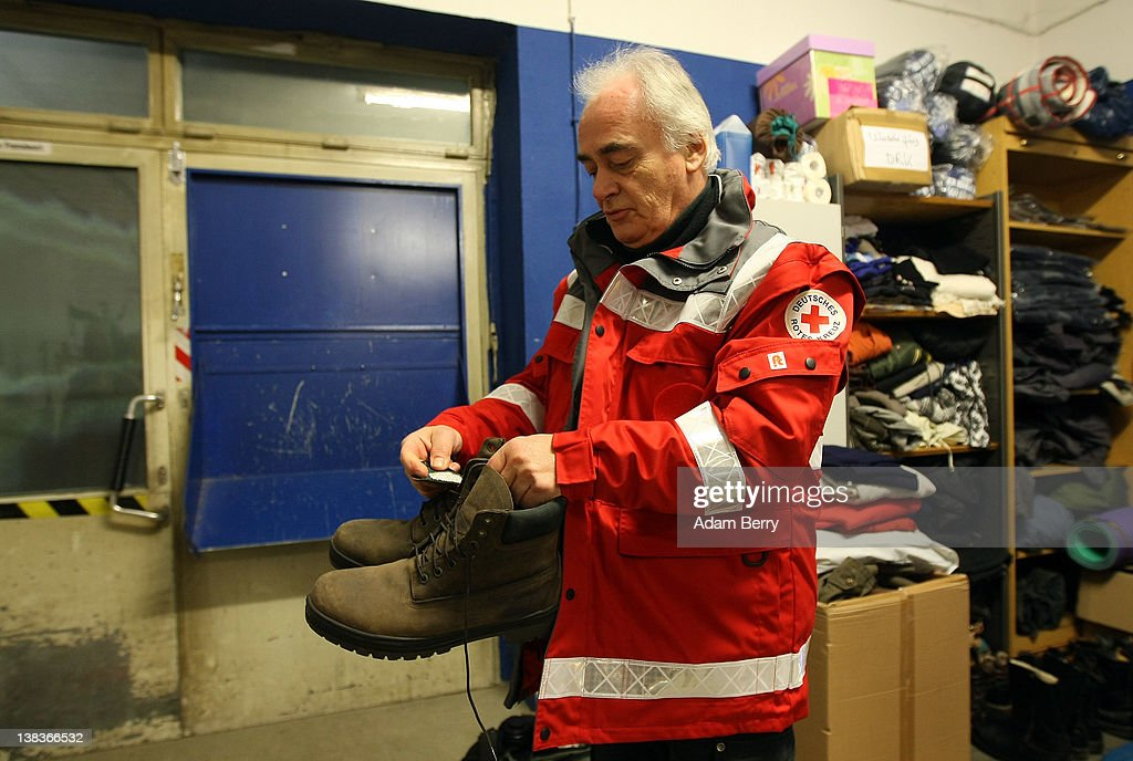 German Red Cross volunteer Carlo Trobisch checks pairs of shoes donated for the homeless on February 6, 2012 prior to making the rounds in the Waermebus, or Warmth Van, in Berlin, Germany. The Waermebus, a program ran by the German Red Cross, assists the homeless in times of extremely low temperatures with blankets, food, clothing and finding lodging. Nearly 300 people across Europe have died during the current cold wave, a majority of whom were without shelter.