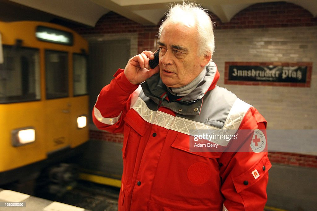 German Red Cross volunteer Carlo Trobisch receives a phone call telling him the location of a homeless man, in the Innsbrucker Platz subway station as he makes the rounds in the Waermebus, or Warmth Van, on February 6, 2012 in Berlin, Germany. The Waermebus, a program ran by the German Red Cross, assists the homeless in times of extremely low temperatures with blankets, food, clothing and finding lodging. Nearly 300 people across Europe have died during the current cold wave, a majority of whom were without shelter.