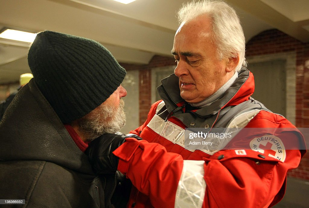 German Red Cross volunteer employee Carlo Trobisch (R) straightens the collar of a homeless man in the Innsbrucker Platz subway station as he makes the rounds in the Waermebus, or Warmth Van, on February 6, 2012 in Berlin, Germany. The Waermebus, a program ran by the German Red Cross, assists the homeless in times of extremely low temperatures with blankets, food, clothing and finding lodging. Nearly 300 people across Europe have died during the current cold wave, a majority of whom were without shelter.